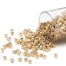 Seed beads, Delica 11/0, opaque galvanized yellow gold, 7,5 gram. DB0410V